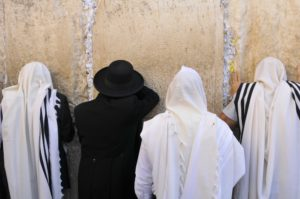 In Judaism, the tallit is worn during Shacharit (morning prayers),
