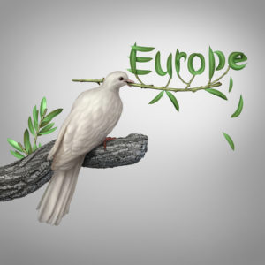 Europe conflict and diplomatic crisis concept as a white dove holding an olive branch with the leaves shaped as text as a hope and risk symbol for peace and finding a peaceful negotiated solution.