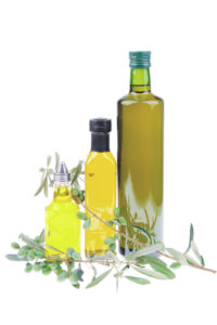 green olives with gold oil over white