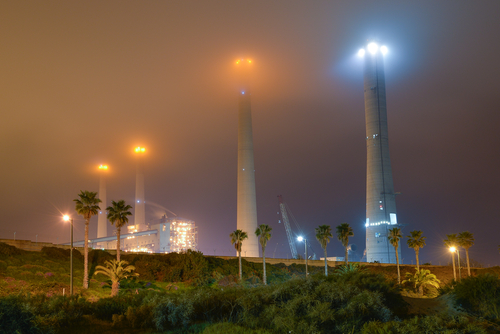 an Israeli power plant Orot Rabin in Hadera at a foggy night