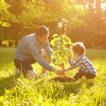 Dad showing child how trees help our environment