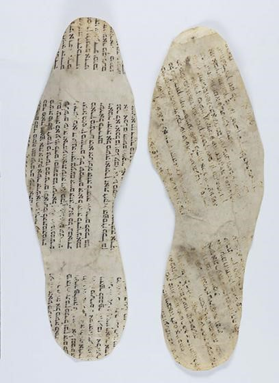 Shoe insoles made from Torah scrolls.