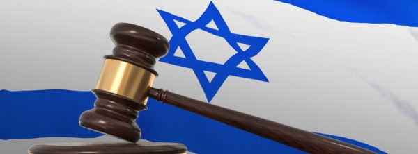 Gavel in front of Israeli flag, representing Israel's legal status.